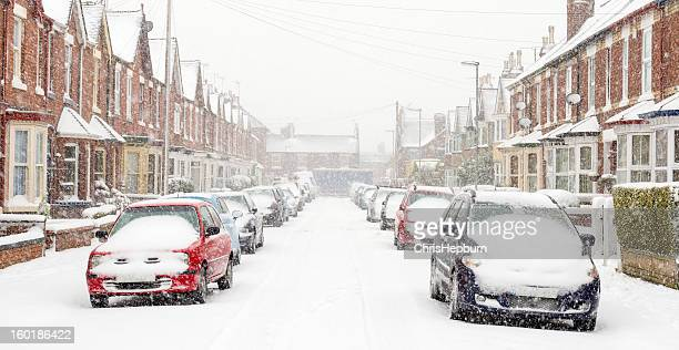 typical uk street in winter snow - winter weather stock photos and pictures