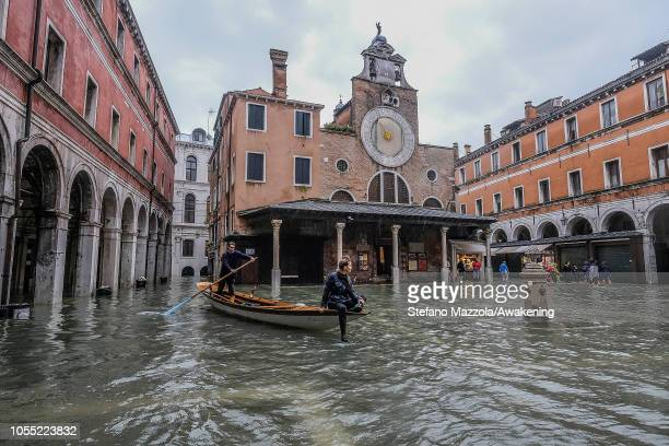 A typical Venetian boat sails in Campo San Giacometto on October 29 2018 in Venice Italy Due to the exceptional level of the acqua alta or High Tide...