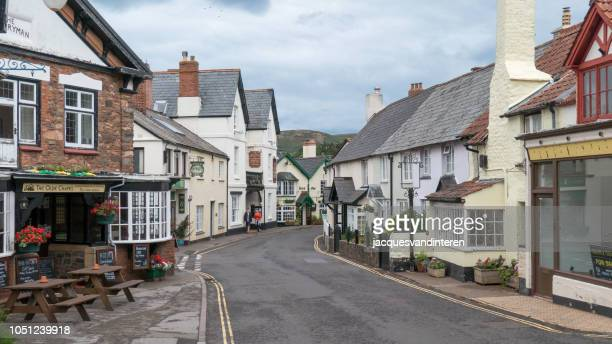 typical village in exeter, england (united kingdom) - exeter england stock pictures, royalty-free photos & images
