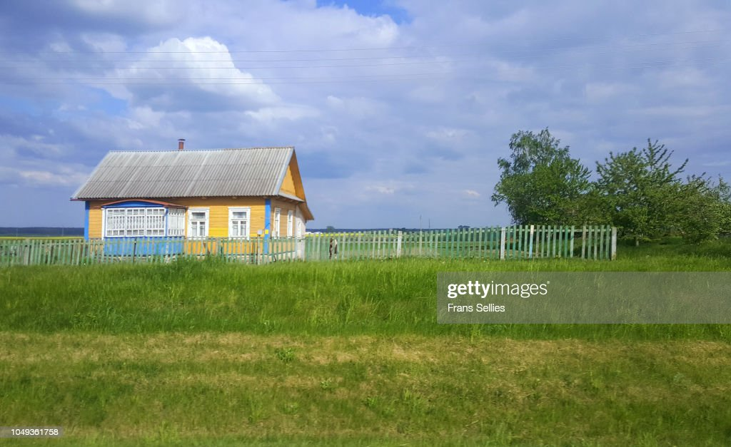 Typical wooden house in the countryside, Belarus : Stock Photo