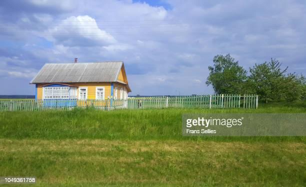 typical wooden house in the countryside, belarus - frans sellies stockfoto's en -beelden