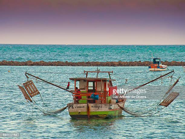 CONTENT] Typical wooden shrimp fishing boat in the NE of Brazil showing the nets