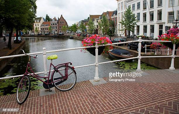 Typically Dutch view of bicycle on a canal bridge Leiden Netherlands