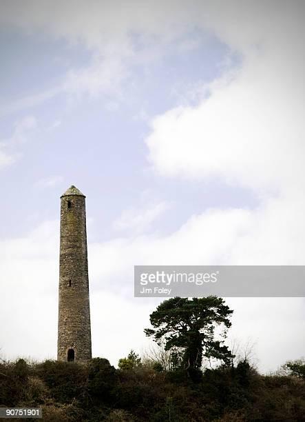 typically irish round tower - irish round tower stock photos and pictures