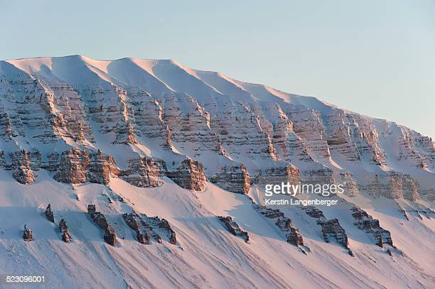 Typically shaped mountain in a wintry Spitsbergen, Svalbard, Norway, Europe