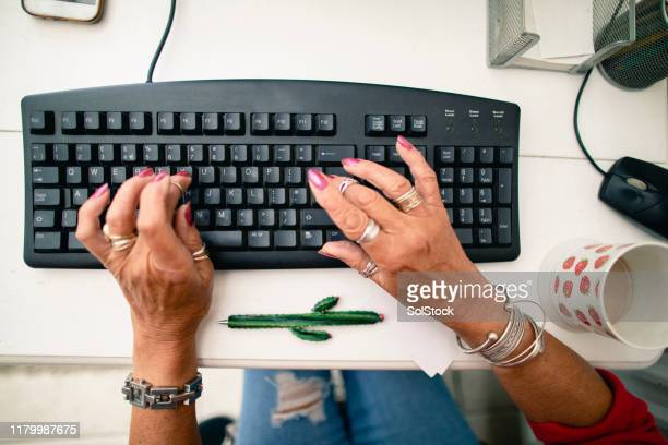 typing away on her keyboard - novelty item stock pictures, royalty-free photos & images