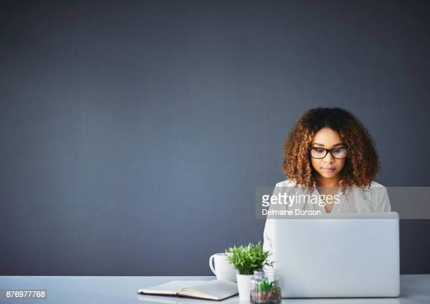 typing her way to success - black blazer stock pictures, royalty-free photos & images