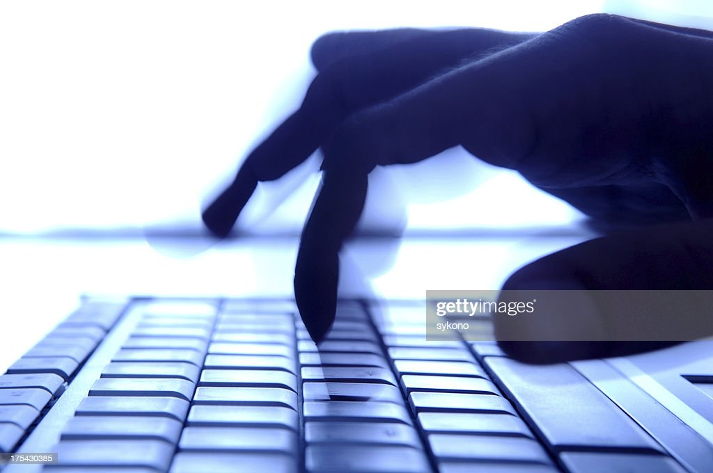 typing in dark : Stock Photo