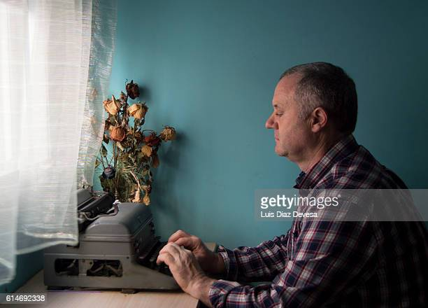 typing on an old typewriter - poet stock pictures, royalty-free photos & images