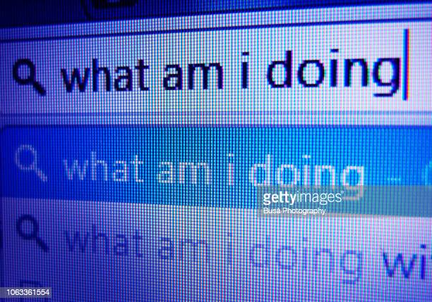 typing on internet search toolbar: what am i doing? - seo stock pictures, royalty-free photos & images