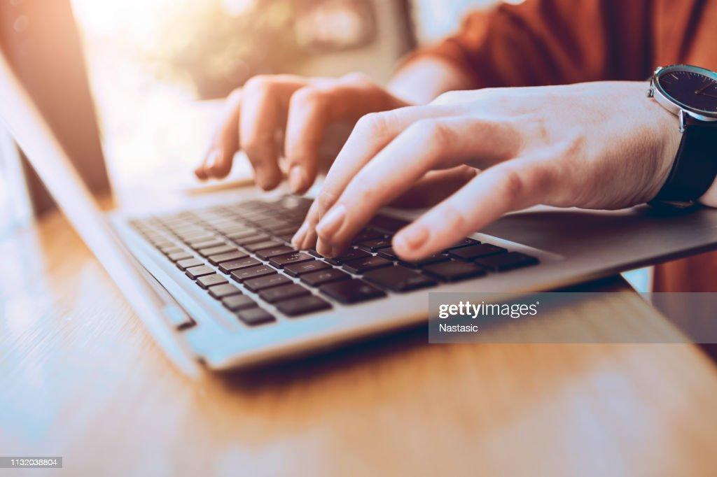 Typing on laptop : Stock Photo