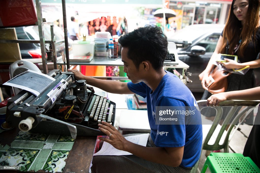A typist works on a typewriter in Yangon, Myanmar, on Thursday, June 15, 2017. A pariah state for decades, Myanmars recent emergence from economic isolation has attracted foreign companies and investors intrigued by the Southeast Asian nations untapped potential, abundant natural resources and low wage workforce. Photograph: Taylor Weidman/Bloomberg via Getty Images
