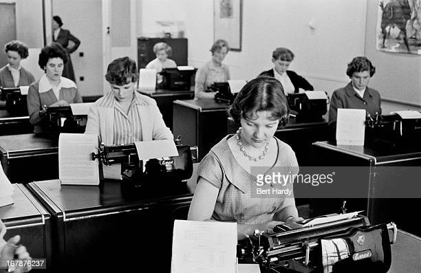 Typists at work at Unilever House in Blackfriars, London, September 1955. Original Publication: Picture Post - 8002 - Leave Youth Alone - pub. 24th...
