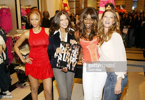 Tyra Banks Adriana Lima Oluchi Onweagba and Gisele Bundchen pose for a photo during the in store book launch for the new Victoria's Secret photo book...
