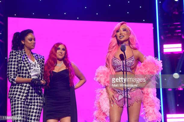 Tyra Banks and Jaclyn Hill present award to Nikita Dragun onstage during the 2nd Annual American Influencer Awards at Dolby Theatre on November 18...