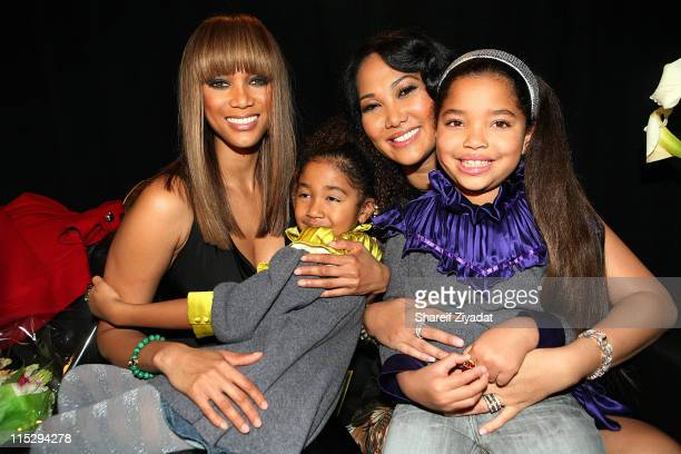 Tyra Banks Aoki Lee Simmons Kimora Lee Simmons and Ming Lee Simmons attend the Baby Phat by Kimora Lee Simmons fashion show during MercedesBenz...