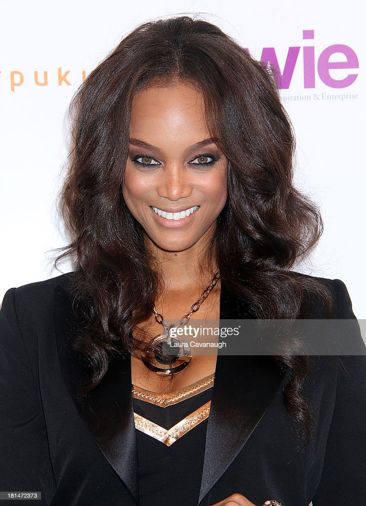 Tyra Banks attends day 2 of the 4th Annual WIE Symposium at Center 548 on September 21, 2013 in New York City.