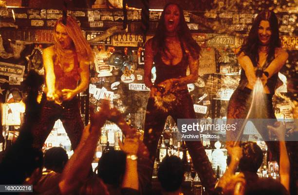 Tyra Banks Izabella Miko and Bridget Moynahan dancing on top of the bar in a scene from the film 'Coyote Ugly' 2000