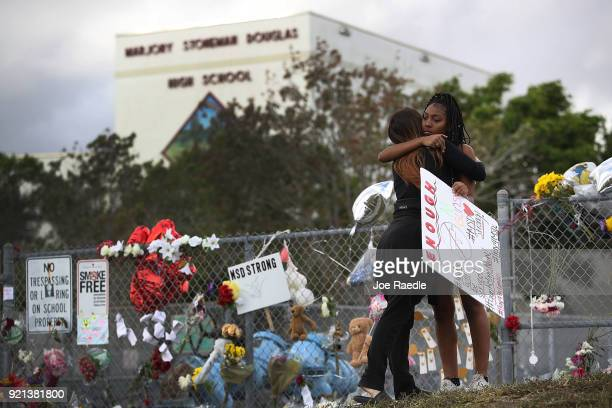 Tyra Heman a senior at Marjory Stoneman Douglas High School is hugged by Rachael Buto in front of the school where 17 people that were killed on...