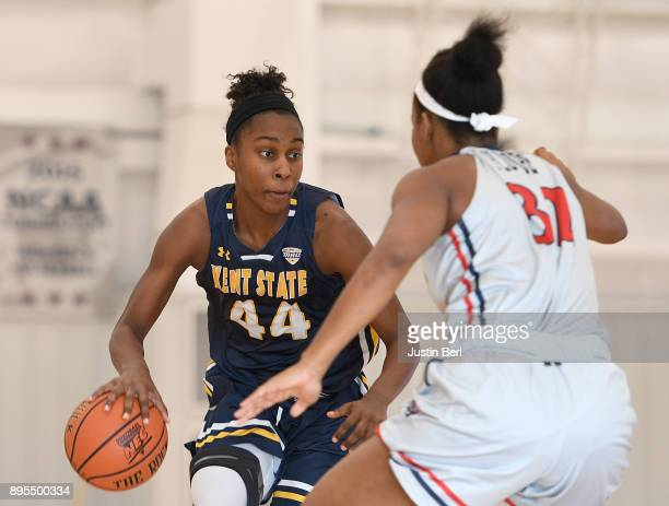 Tyra James of the Kent State Golden Flashes dribbles against Nadege Pluviose of the Robert Morris Colonials in the second half during the game at...