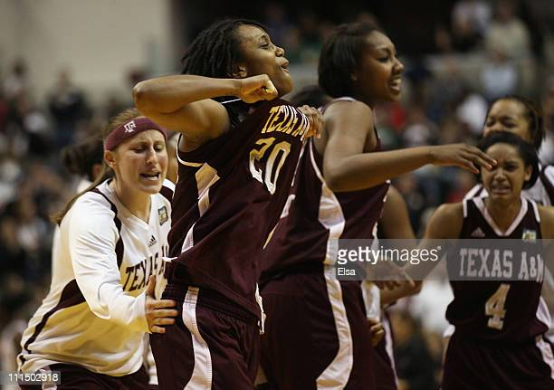 Tyra White of the Texas AM Aggies celebrates the win with her teammates after the game against the Stanford Cardinal during the semifinals of the...