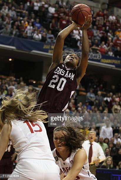 Tyra White of the Texas AM Aggies makes the game winning basket against the Stanford Cardinal Jeanette Pohlen and Lindy La Rocque of the Stanford...