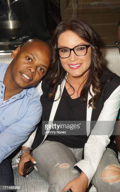 Tyran 'Ty Ty' Smith and Angie Martinez attend The Super Heroes Fundraiser And Domino Tournament at The 40/40 Club on June 24 2013 in New York City