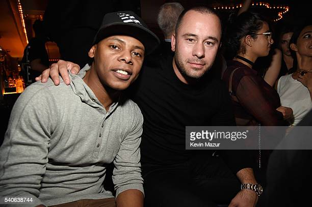 Tyran 'Ty Ty' Smith and Manager Phil McIntyre attend the celebration of Nick Jonas' collaboration with Altec Lansing and album release at UpDown on...