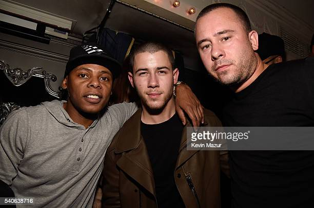 Tyran 'Ty Ty' Smith Nick Jonas and manager Phil McIntyre attend the celebration of Nick Jonas' collaboration with Altec Lansing and album release at...