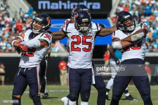 Tyrann Mathieu, Kareem Jackson and Justin Reid of the Houston Texans celebrate Mathieu's second half interception against the Jacksonville Jaguars at...