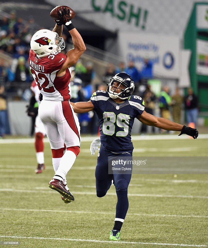 Tyrann Mathieu #32 of the Arizona Cardinals intercepts a pass intended for Doug Baldwin #89 of the Seattle Seahawks during the third quarter at CenturyLink Field on November 15, 2015 in Seattle, Washington.