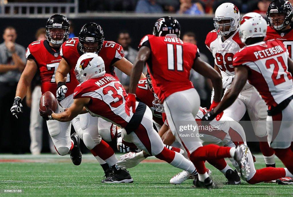 Tyrann Mathieu #32 of the Arizona Cardinals intercepts this pass against the Atlanta Falcons at Mercedes-Benz Stadium on August 26, 2017 in Atlanta, Georgia.