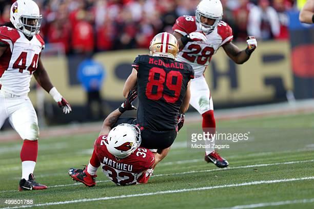 Tyrann Mathieu of the Arizona Cardinals tackles Vance McDonald of the San Francisco 49ers during the game at Levi Stadium on November 29 2015 in...