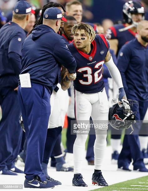 Tyrann Mathieu of the Houston Texans shakes hands with head coach Bill O'Brien of the Houston Texans after defeating the Jacksonville Jaguars and...