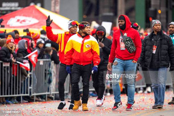 Tyrann Mathieu of the Kansas City Chiefs and Reggie Ragland of the Kansas City Chiefs walk the parade route with defensive teammate on February 5...
