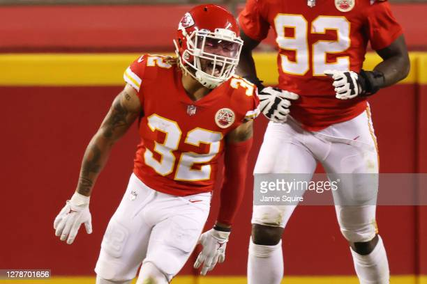 Tyrann Mathieu of the Kansas City Chiefs celebrates after scoring a pick six in theh fourth quarter against the New England Patriots at Arrowhead...