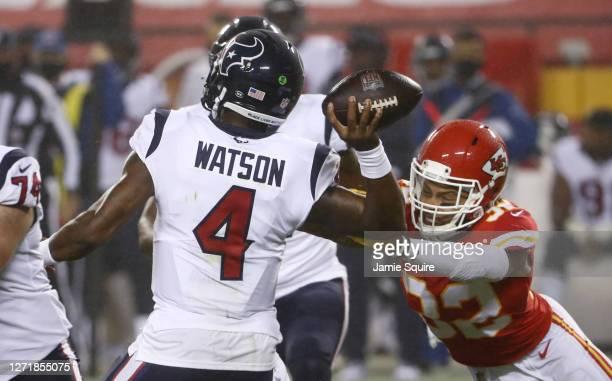 Tyrann Mathieu of the Kansas City Chiefs gets a hand on Deshaun Watson of the Houston Texans causing an interception during the fourth quarter at...