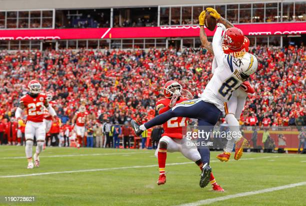 Tyrann Mathieu of the Kansas City Chiefs intercepts a second quarter pass intended for Mike Williams of the Los Angeles Chargers at Arrowhead Stadium...