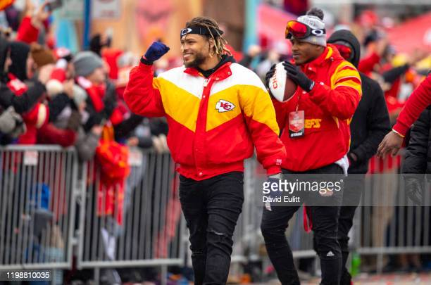 Tyrann Mathieu of the Kansas City Chiefs walks the parade route with defensive teammate on February 5 2020 in Kansas City Missouri during the citys...