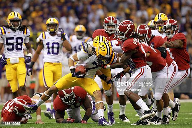 Tyrann Mathieu of the Louisiana State University Tigers is tackled by Dre Kirkpatrick of the Alabama Crimson Tide during the 2012 Allstate BCS...
