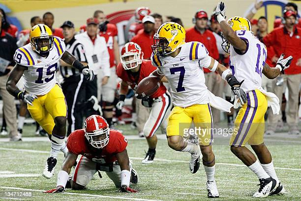 Tyrann Mathieu of the LSU Tigers returns a punt 62yards for a touchdown in the second quarter against the Georgia Bulldogs during the 2011 SEC...