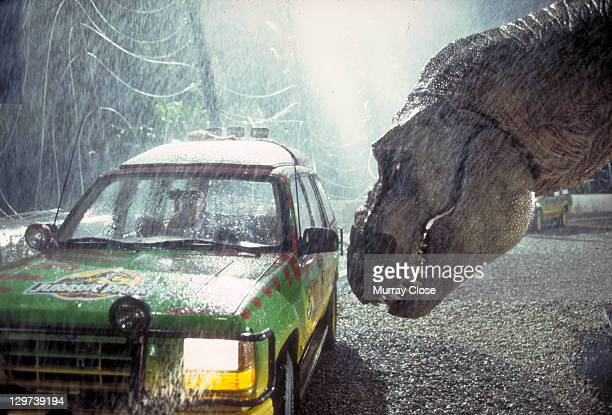 A Tyrannosaurus Rex menaces the theme park's first customers in a scene from the film 'Jurassic Park' 1993
