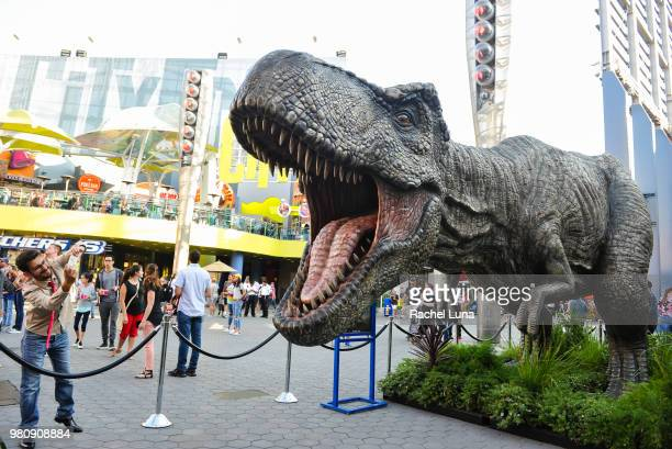 Tyrannosaurus rex towering 13feet tall by 36feet wide and weighing three tons is displayed outside Universal Cinema before an advanced screening of...