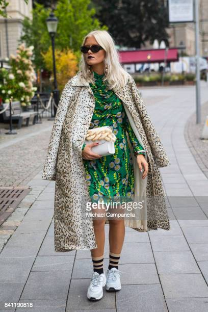 TyraStina Wilhelmsson with a handbag from Marques Almeida on second day of Stockholm Fashion Week Spring/Summer 18 at Grand Hotel on August 31 2017...