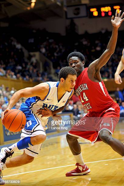 Tyre Desmore of the WinstonSalem State Rams defends Seth Curry of the Duke Blue Devils at Cameron Indoor Stadium on November 1 2012 in Durham North...