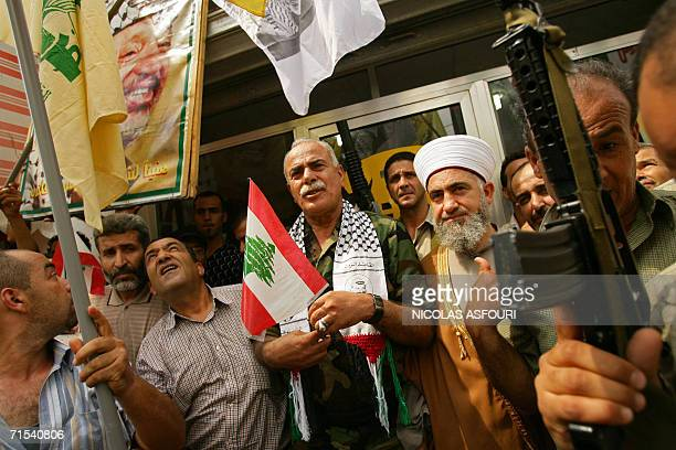 Head of the PLO in Lebanon Sultan Abu elEnein and main religious leader of AlBass Palestinian refugee camp Sheikh Hussein Qassem stand outside the...