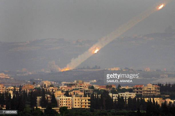Katyusha rockets are fired from the outskirts of the southern Lebanese port city of Tyre into Israel 06 August 2006 Amnesty International denounced...