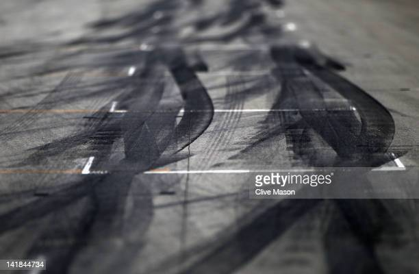 Tyre marks on the grid are seen before the start of the Malaysian Formula One Grand Prix at the Sepang Circuit on March 25 2012 in Kuala Lumpur...
