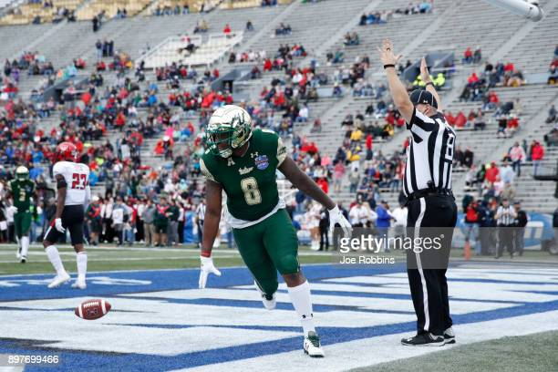 Tyre McCants of the South Florida Bulls reacts after a touchdown reception against the Texas Tech Red Raiders in the first half of the Birmingham...