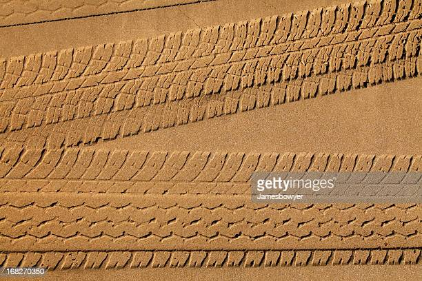 tyre tracks in sand - track imprint stock photos and pictures